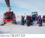 During winter the helicopter is the only link to the rest of Greenland... Редакционное фото, фотограф Martin Zwick / age Fotostock / Фотобанк Лори