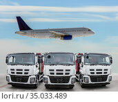 Three trucks are frontal front view and the plane is flying in the sky. Стоковое фото, фотограф Юрий Бизгаймер / Фотобанк Лори
