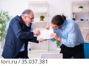 Old boss and his young assistant in the office. Стоковое фото, фотограф Elnur / Фотобанк Лори