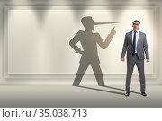 Concept of businessman liar with his shadow. Стоковое фото, фотограф Elnur / Фотобанк Лори