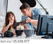 Young photographer working in photo studio. Стоковое фото, фотограф Elnur / Фотобанк Лори