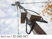Power pole with street light and wires. Стоковое фото, фотограф EugeneSergeev / Фотобанк Лори