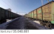 Close-up of freight trains at the station. Стоковое видео, видеограф Mikhail Erguine / Фотобанк Лори