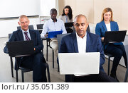 Group of people working with laptops during business training. Стоковое фото, фотограф Яков Филимонов / Фотобанк Лори