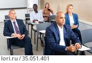 Focused people of during business seminar in lecture hall. Стоковое фото, фотограф Яков Филимонов / Фотобанк Лори