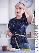 Sad girl measuring waist. Стоковое фото, фотограф Яков Филимонов / Фотобанк Лори