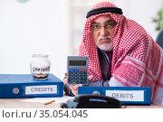 Male arab bookkeeper in retirement concept. Стоковое фото, фотограф Elnur / Фотобанк Лори