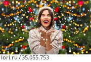 happy woman over christmas tree lights and snow. Стоковое фото, фотограф Syda Productions / Фотобанк Лори