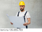 male worker or builder in helmet with blueprint. Стоковое фото, фотограф Syda Productions / Фотобанк Лори