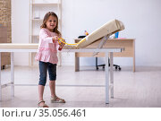 Small girl holding stethoscope waiting for doctor in the clinic. Стоковое фото, фотограф Elnur / Фотобанк Лори