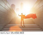Businessman superhero pressing virtual buttons on career ladder. Стоковое фото, фотограф Elnur / Фотобанк Лори