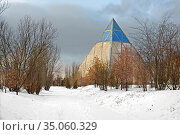 Palace of Peace and Reconciliation (Pyramid of Peace and Accord) in snowy park. Nur Sultan. Редакционное фото, фотограф Валерия Попова / Фотобанк Лори