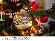 Decorated christmas tree with balls, baubles and lights, selective focus. Стоковое фото, фотограф Юлия Бабкина / Фотобанк Лори