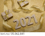 Happy New Year. Craft gifts and handcrafted lettering 2021 on gold background. Стоковое фото, фотограф Сергей Молодиков / Фотобанк Лори
