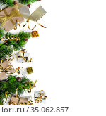 New Year card. Bright craft gifts decorated with gold ribbon, christmas trees, tinsel and serpentine isolated on white. Стоковое фото, фотограф Сергей Молодиков / Фотобанк Лори