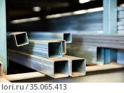 Steel structural channels, tubes on shelves. Стоковое фото, фотограф Яков Филимонов / Фотобанк Лори