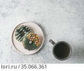 Vegan donuts topped spirulina glaze and tea. Стоковое фото, фотограф Ольга Сергеева / Фотобанк Лори