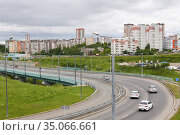 Section of a bypass road with a bend and an overpass in Perm, Russia. Редакционное фото, фотограф Евгений Харитонов / Фотобанк Лори