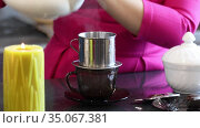 Woman prepares traditional Vietnamese coffee at the bar. Стоковое видео, видеограф Алексей Кузнецов / Фотобанк Лори
