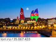 Flame Towers in the colors of the flag of Turkey and Azerbaijan - original neon lighting. State symbols of the Turkish and Azerbaijan Republics. Редакционное фото, фотограф Евгений Ткачёв / Фотобанк Лори