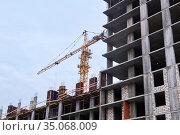 Building under construction and crane against the sky. Стоковое фото, фотограф Евгений Харитонов / Фотобанк Лори