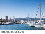 Sailing yachts and motor boats moored in marina (2015 год). Стоковое фото, фотограф EugeneSergeev / Фотобанк Лори