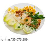 Tasty fried codfish served with endive, greens and corn. Стоковое фото, фотограф Яков Филимонов / Фотобанк Лори
