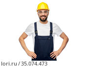 happy male worker or builder in helmet and overall. Стоковое фото, фотограф Syda Productions / Фотобанк Лори