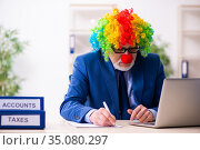 Old businessman clown working in the office. Стоковое фото, фотограф Elnur / Фотобанк Лори