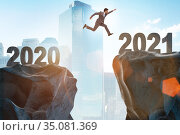Businessman jumping from the year 2020 to 2021. Стоковое фото, фотограф Elnur / Фотобанк Лори