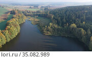Picturesque autumn rural landscape with colorful trees by lake. Стоковое видео, видеограф Яков Филимонов / Фотобанк Лори