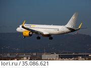 Vueling Airbus EC-NDA approaching to runway at El Prat Airport. Редакционное фото, фотограф Яков Филимонов / Фотобанк Лори