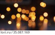 blurred christmas lights in darkness. Стоковое видео, видеограф Syda Productions / Фотобанк Лори