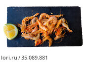 Breaded shrimps served with slice of lime. Стоковое фото, фотограф Яков Филимонов / Фотобанк Лори
