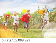 Four cheerful kids running on green lawn. Стоковое фото, фотограф Яков Филимонов / Фотобанк Лори