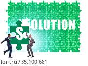 Solution concept with businessman solving jigsaw puzzle. Стоковое фото, фотограф Elnur / Фотобанк Лори