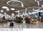 Decorated interior of the Mega shopping mall is at Christmas time. It is located in Kudrovo. St. Petersburg. Редакционное фото, фотограф Кекяляйнен Андрей / Фотобанк Лори
