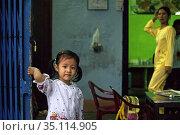 Coy smiling young girl inside a restaurant, Hue, Vietnam, Southeast... Редакционное фото, фотограф Sergi Reboredo / age Fotostock / Фотобанк Лори
