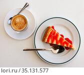 Slice of delicious classical cheesecake with fruity sauce served. Стоковое фото, фотограф Яков Филимонов / Фотобанк Лори