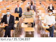 Business people listening to coach at conference. Стоковое фото, фотограф Яков Филимонов / Фотобанк Лори