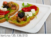 Sandwich with guacamole, feta cheese, vegetables. Стоковое фото, фотограф Яков Филимонов / Фотобанк Лори