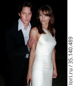 Hugh Grant Elizabeth Hurley, 1999, Photo By John Barrett/PHOTOlink (2008 год). Редакционное фото, фотограф Adam Scull / age Fotostock / Фотобанк Лори