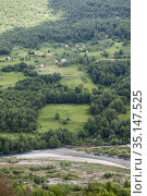 Farms are on slopes of mountains in the Durmidor massif over the Tara river. Northwestern Montenegro. (2016 год). Стоковое фото, фотограф Кекяляйнен Андрей / Фотобанк Лори