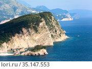 The Sveti Nikola or St. Nicolas island is in Budva riviera. Cliffs from the Adriatic sea. Montenegro (2016 год). Стоковое фото, фотограф Кекяляйнен Андрей / Фотобанк Лори