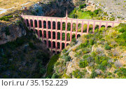 Aqueduct of Eagle over canyon of Barranco de la Coladilla, Nerja, Spain. Стоковое фото, фотограф Яков Филимонов / Фотобанк Лори