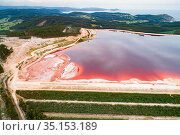 Aerial view of red mud / alumina deposits, where with a highly alkaline waste product produced by the industrial production of aluminium is stored. Located on seashore in Galicia, Northern Spain. Стоковое фото, фотограф Milan Radisics / Nature Picture Library / Фотобанк Лори