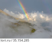 Landscape with rainbow and clouds in the National Park Hohe Tauern... Стоковое фото, фотограф Martin Zwick / age Fotostock / Фотобанк Лори