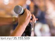 Female hand holding microphone at conference hall. Стоковое фото, фотограф Яков Филимонов / Фотобанк Лори