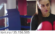 Young pretty woman training her boxing on the ring. Стоковое видео, видеограф Константин Шишкин / Фотобанк Лори