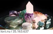 Set of various colorful semi-precious stones spinning on a black background. Стоковое видео, видеограф Алексей Кузнецов / Фотобанк Лори